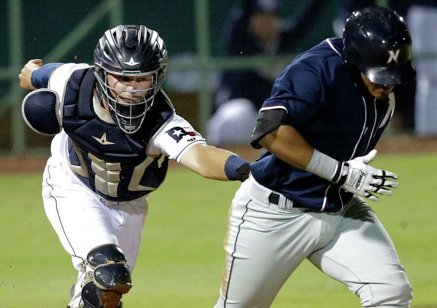 San Antonio catcher A.J. Kennedy tags out Samir Duenez on a dropped ball third strike in the fifth inning as the Missions host Northwest Arkansas at Wolff Stadium on April 13, 2017.