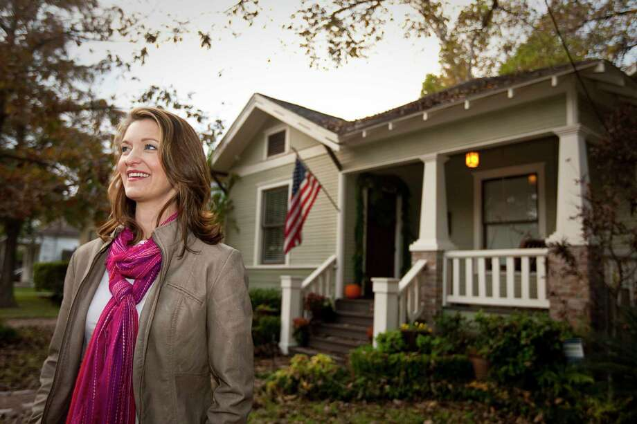 In 2012, Wendy Parker celebrated Germantown's being designated a city historic district, with approval by 68 percent of the area's homeowners. HB 3418 would raise the requirement to 75 percent, a number rarely reached in democratic elections. Photo: Nick De La Torre, Houston Chronicle / © 2012  Houston Chronicle