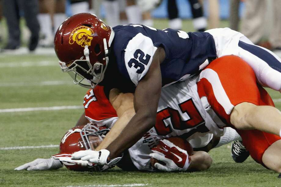 ST. PETERSBURG, FL - JANUARY 21:  West's Leon McQuay III #32 of Southern California slams down East's Gehrig Dieter #12 of Alabama after the catch near the one yard line during the fourth quarter of the East-West Shrine Game at Tropicana Field on January 21, 2017, in St. Petersburg, Florida. (Photo by Joseph Garnett, Jr. /Getty Images) Photo: Joseph Garnett Jr./Getty Images