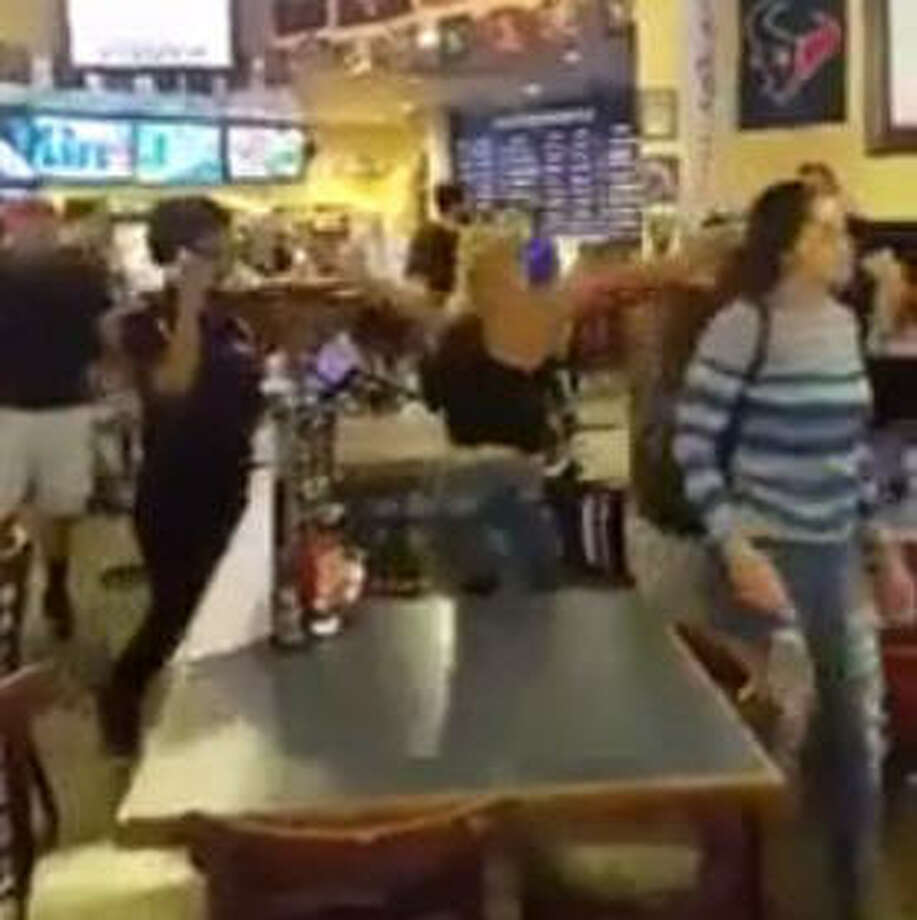 No one was injured during a brawl in which customers threw chairs at each other in the dining room of Bayou City Wings, Gulf Freeway and Fuqua in southeast Houston,Tuesday, April 11, 2017. Cellphone video of the incident was widely shared on social media. Photo: Screen Shot From Video Via Shade Media