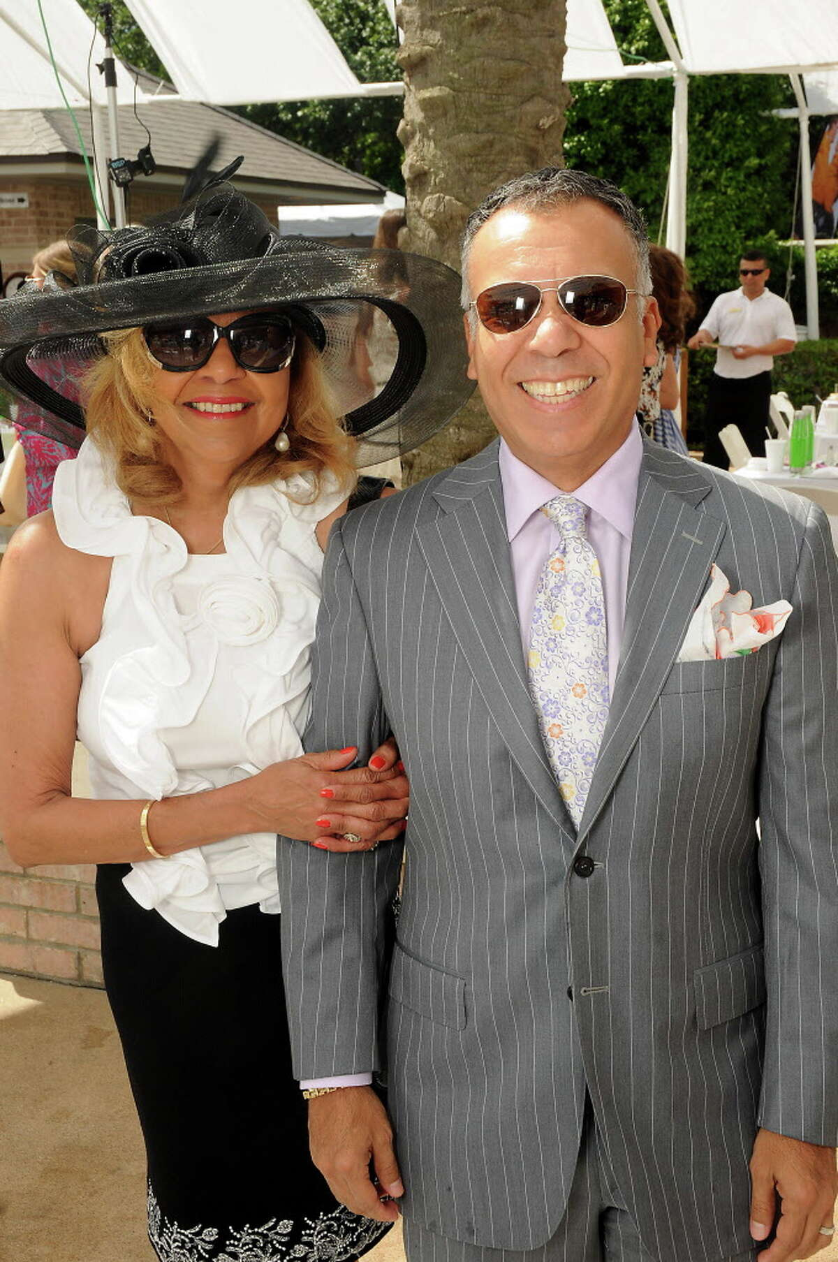 Yvonne Cormier and Tony Bravo at the Tootsies Fashion show at River Oaks Country Club Thursday April 13,2017.(Dave Rossman Photo)