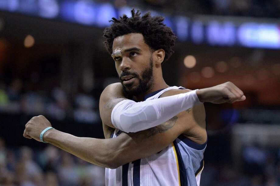 Memphis Grizzlies guard Mike Conley (11) stands on the court before the start of an NBA basketball game against the Detroit Pistons Sunday, April 9, 2017, in Memphis, Tenn. Photo: Brandon Dill /Associated Press / FR171250 AP
