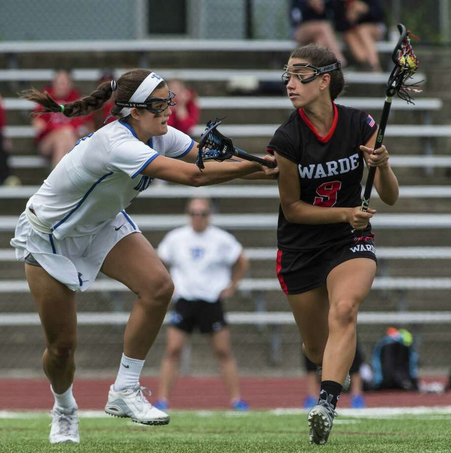 Warde's Courtney Scheetz looks to attack against Darien in last spring's Class L chanmpionship game. Scheetz, a midfielder, scored 35 goals and added 16 assists to earn All-State honors, returns for coach Tom Davis. Photo: Mark Conrad / For Hearst Connecticut Media / Connecticut Post Freelance