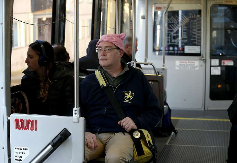 Mickey Lim's L-Taraval ride from his Castro job to his Outer Sunset home is un pre dictable be cause he of ten has to switch trains. Photo: Paul Chinn, The Chronicle