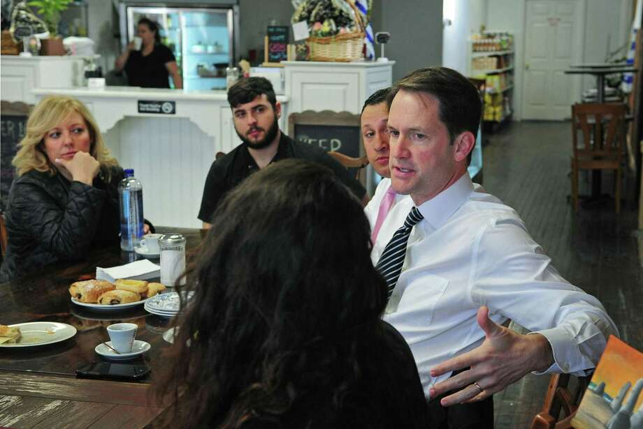 US Congressman Jim Himes leads a roundtable discussion Thursday morning, April 13, 2017, with local Latino community leaders including Mariella Castagnet, Mathias Sellanes and Warren Pena at Capris Cuisine in Norwalk, Conn. The discussion focused on the communities' thoughts and concerns regarding education, business and immigration. Photo: Erik Trautmann / Hearst Connecticut Media / Norwalk Hour