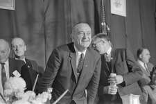 (Original Caption) President Lyndon B. Johnson rises to acknowledge the loud applause he received as he joined head table host, Governor John W. King of New Hampshire (R) at dinner here 9/28.