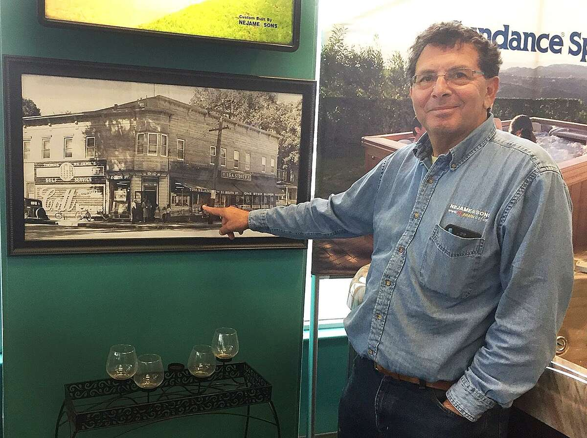 Tom Nejame of Nejame & Sons points on Tuesday, April 4, 2017, to an undated photograph of the general store that opened in 1921 and was the start of the Nejame family business in Danbury, Conn.