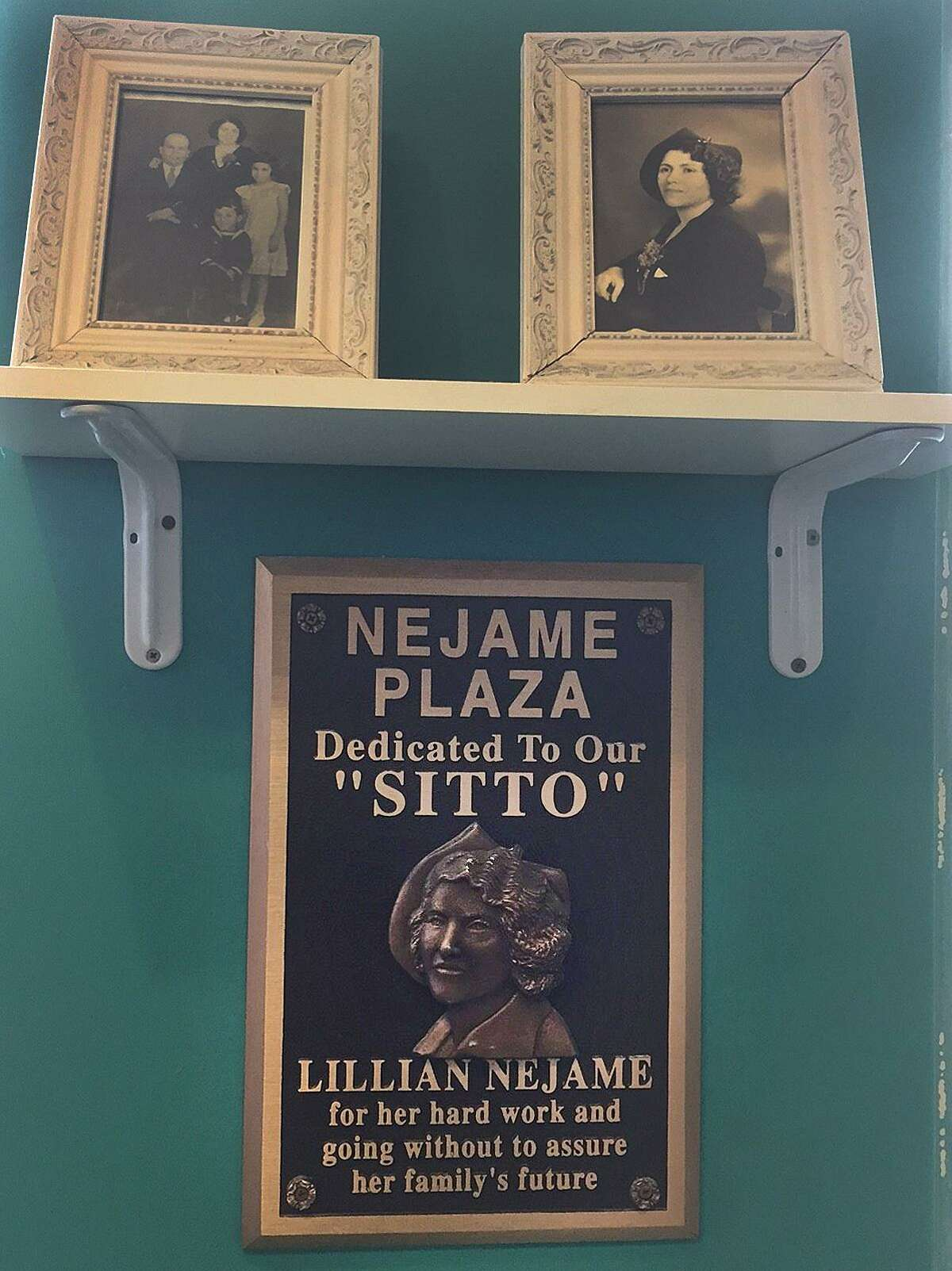 A plaque at the entrance to Nejame & Sons honors Lillian Nejame, the matriarch of the 96-year-old company, in Danbury, Conn.