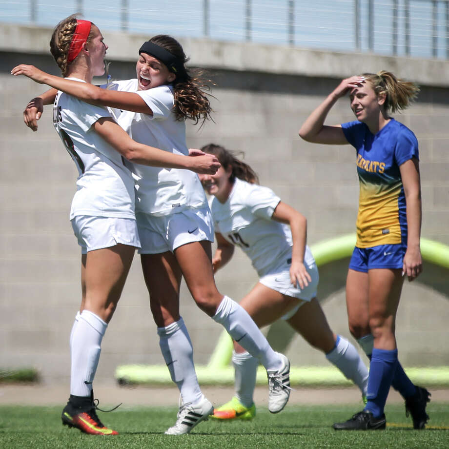 The Woodlandsí Sarah Piper (28) celebrates with Kate McCullough (2) after scoring a goal during the varsity girls soccer game against Klein on Friday, April 7, 2017, at Kelly Reeves Stadium in Austin. Photo: Michael Minasi/Houston Chronicle