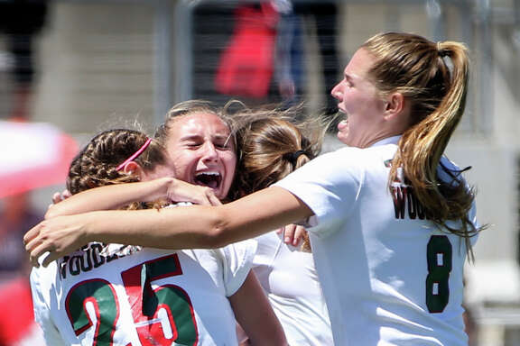 The Woodlands Lady Highlanders celebrate during the varsity girls soccer game against Klein on Friday, April 7, 2017, at Kelly Reeves Stadium in Austin.