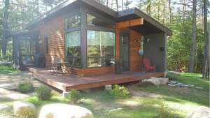 """Lake Placid, NY . B Bedroom Eco-Cottage. Price: $120. A unique, new and eco-friendly """"Tiny Home"""" built with style, and comfort in mind. This two bedroom house is great for families and couples alike. Located just minutes outside of Lake Placid and Saranac Lake, perfect for your Adk. vacation.   View full listing on Airbnb  ."""