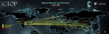 A map of real-time, continually updated data shows  cyberattacks trying to get inside the USAA firewall last month in this screen capture provided by USAA. The text at the top center of the image indicates how many attacks had been blocked in the preceding 24 hours.