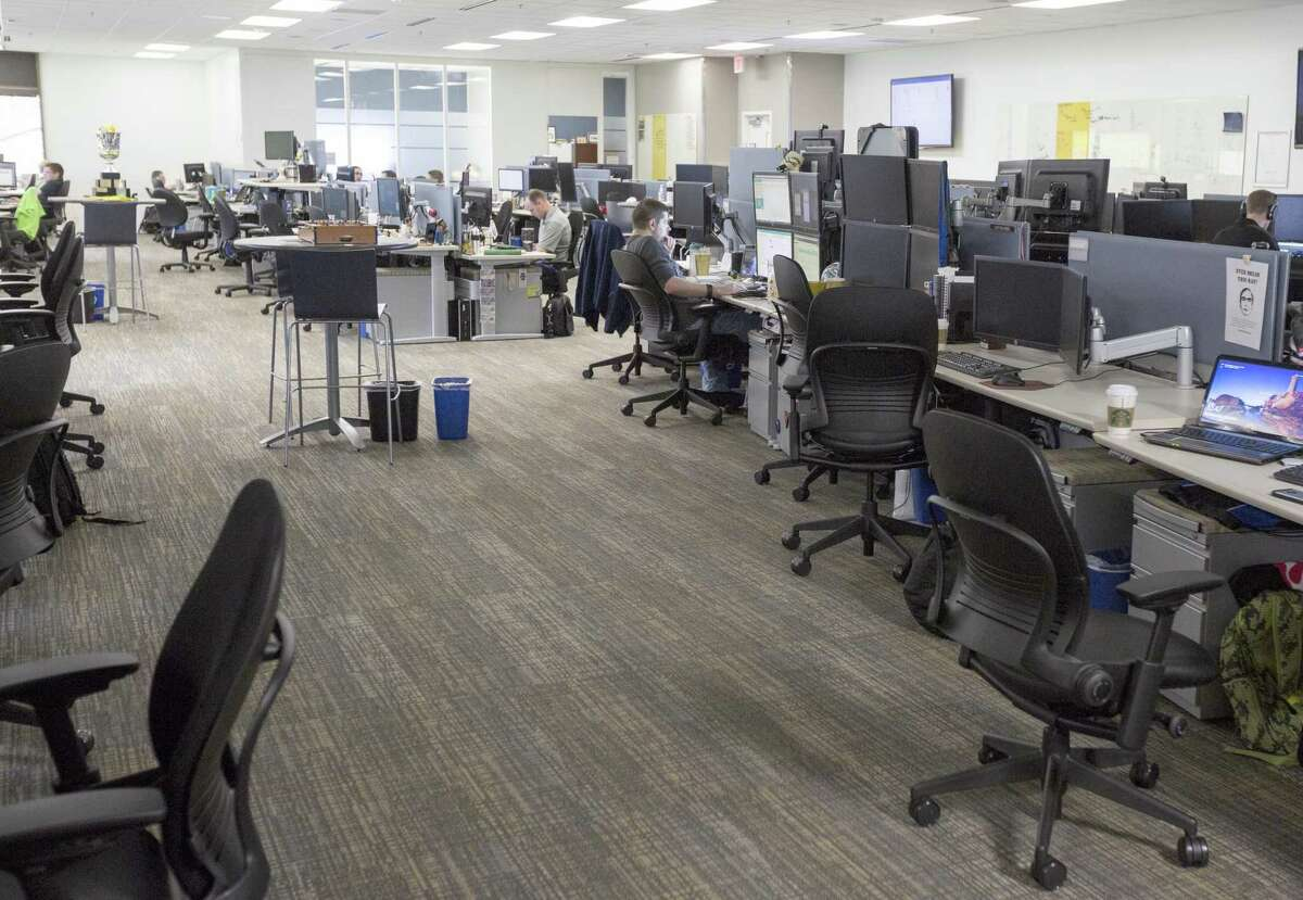 Cyber warriors at USAA cybersecurity work in the company's headquarters on Fredericksburg Road. They're the company's
