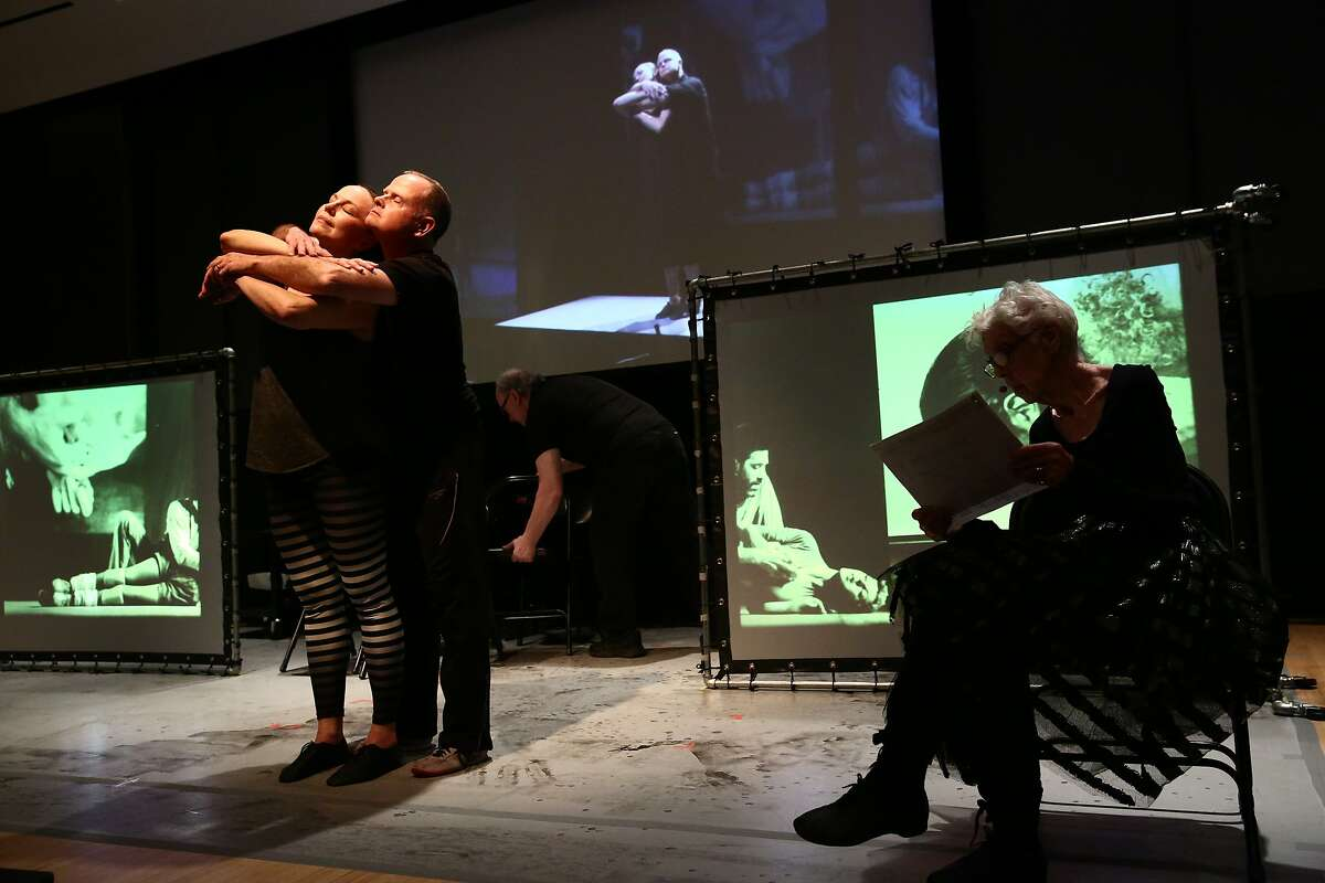"""Scott Cunningham and Karen Graham embrace while Valda Setterfield reads in the world premiere of David Gordon's """"Live Archiveography"""" at ODC Theater. Photo: Paula Court"""