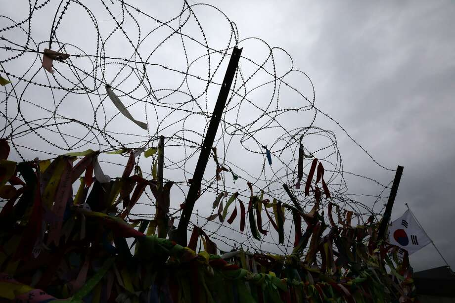 A barbed wire fence at the Imjingak, near the Demilitarized zone (DMZ) separating South and North Korea on April 14, 2017 in Paju, South Korea. South Korean surgeons operating on a North Korean defector who ran across the Demilitarized Zone between the two countries under a hail of gunfire on Monday have found a parasite in the man's stomach unlike any other they had seen. Photo: Chung Sung-Jun/Getty Images