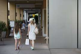 Shoppers walk through the Scottsdale Quarter shopping mall in Scottsdale, Arizona, U.S., on Tuesday, April 11, 2017. The U.S. Census Bureau is scheduled to release retail sales figures on April 14. Photographer: Caitlin Ohara/Bloomberg
