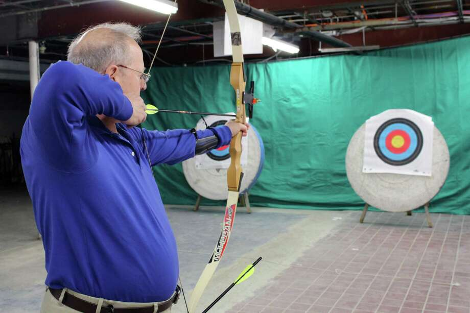 Sandy Block, of Weston, at Wilton Archery Club's grand opening on Thursday, April 13, at Way of the Sword, 21 Governor Street, in Ridgefield. Photo: Stephanie Kim / Hearst Connecticut Media
