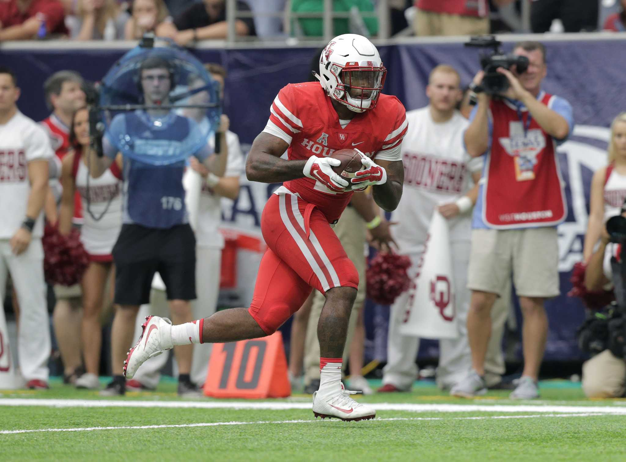 uh working to put the rb back in running game houston chronicle