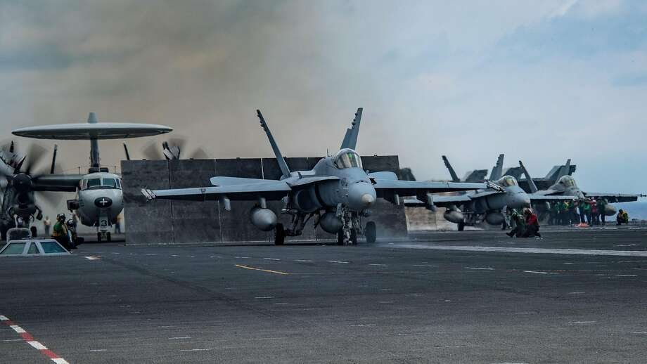 An F/A-18C Hornet prepares to launch from the aircraft carrier USS Carl Vinson during deployment in the Western Pacific, April 10, 2017. The photo was released by the U.S. Navy. With signs indicating that North Korea could be planning a nuclear or missile test as early as Saturday, April 15, 2017, a United States Navy strike group led by the Carl Vinson is steaming toward the Korean Peninsula in a show of force. (U.S. Navy photo by Mass Communication Specialist Seaman Jake Cannady via The New York Times) Photo: MCSA Jake Cannady, NYT