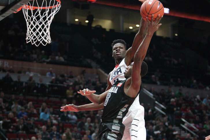 Team USA's Mohamed Bamba blocks a shot by World Select Team's R.J. Barrett during the Nike Hoop Summit basketball game in Portland, Ore., on April 7, 2017.