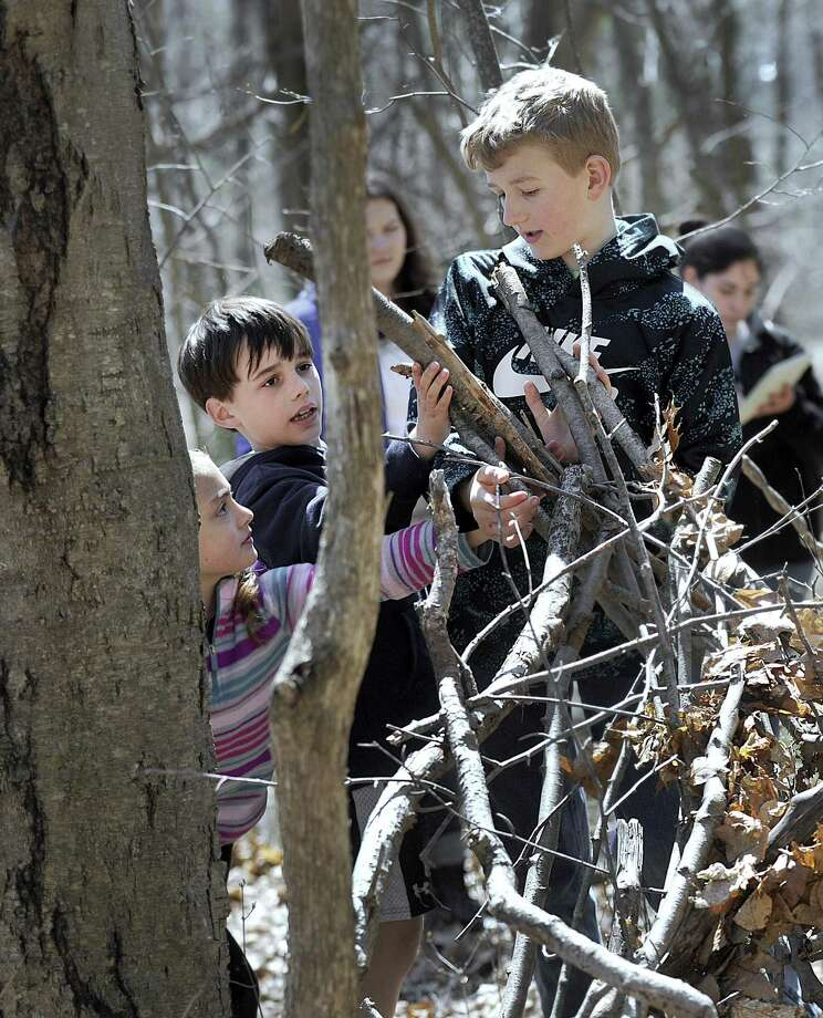 From left, Brooke Mould, 8, Owen Kent, 9, and Jack Morrison, 12, all of New Milford, build a fort Thursday, April 13, 2017 at The Pratt Nature Center in New Milford. The Center is celebrating its 50th anniversary this year. Photo: Carol Kaliff / Hearst Connecticut Media / The News-Times