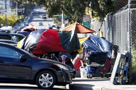 A homeless encampment is established at Vermont and 15th streets in San Francisco, Calif. on Friday, April 14, 2017. A Public Works sweep of an encampment on the other side of the freeway disrupted the progress made by the city's Homeless Outreach Team.
