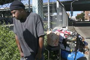 Terrance Banks stands with his belongings at a homeless encampment at Vermont and 15th streets in San Francisco, Calif. on Friday, April 14, 2017. Banks was forced relocate after a Public Works department sweep of an encampment on the other side of the freeway disrupted the progress made by the city's Homeless Outreach Team.