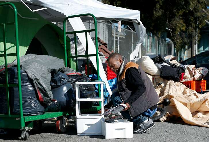 Ricky Walker reorganizes his belongings at a homeless encampment on Vermont Street in San Francisco, Calif. on Friday, April 14, 2017. Walker was forced relocate after a Public Works department sweep of an encampment on the other side of the freeway disrupted the progress made by the city's Homeless Outreach Team.
