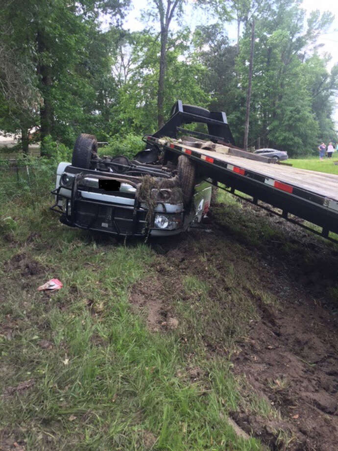 A Beaumont hotshot driver was killed Thursday afternoon when he lost control of his vehicle, causing it to roll over in a ditch before coming to rest with the gooseneck trailer he was pulling on top of the vehicle. Photo: Submitted