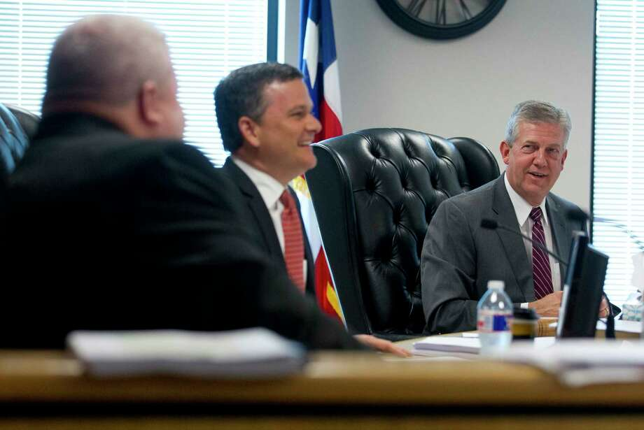 Montgomery County Judge Craig Doyal shares a laugh with Precinct 3 Commissioner James Noack during recent Commissioners Court meeting. Photo: Jason Fochtman, Staff Photographer / © 2017 Houston Chronicle