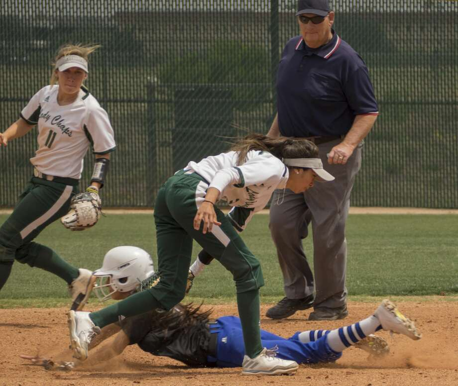 Western Texas' Aryn Flores slides under the tag of Midland College's Melina Martinez stealing second but is tagged out moments later by MC's Kassie Maddox when she steps off the bag 04-14-17 at Midland College softball field. Tim Fischer/Reporter-Telegram Photo: Tim Fischer/Midland Reporter-Telegram