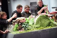 Chefs Sarah Grueneberg, Mike Gulotta, Jason Dady of San Antonio and Jonathon Sawyer grabbing ingredients for the CHariman Challenge, as seen on Iron Chef Gauntlet, Season 1.