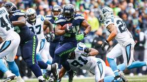 Seattle Seahawks player Marshawn Lynch gains yards against the Carolina Panthers on Sunday, October 18, 2015. (Joshua Trujillo, seattlepi.com)