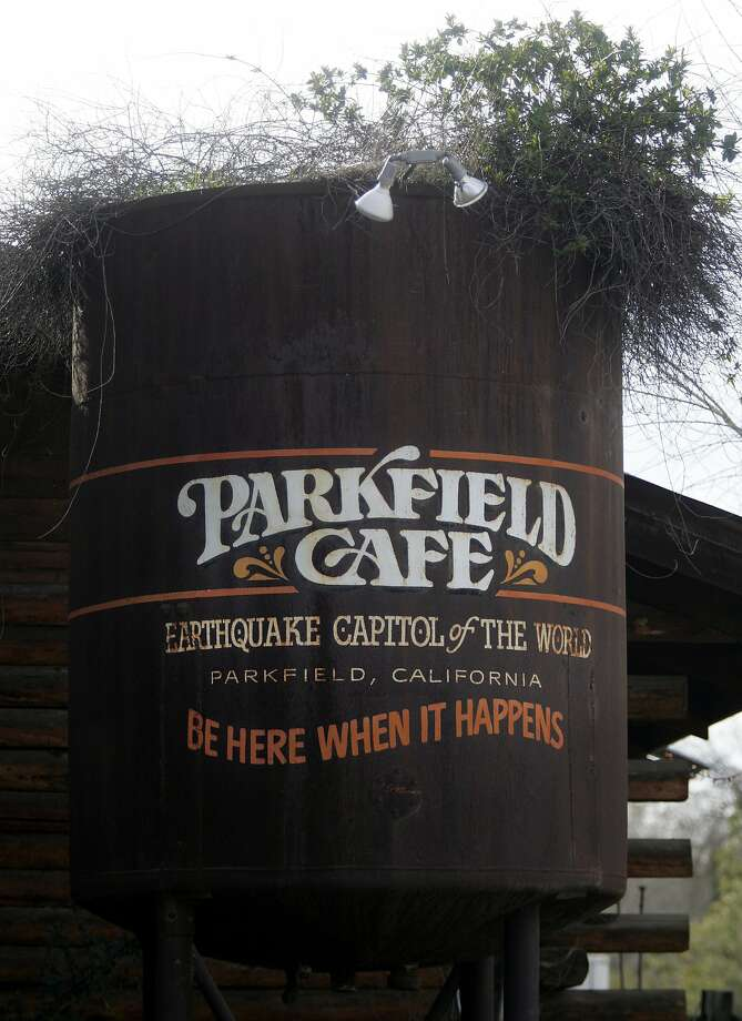 """The sign outside the Parkfield Cafe in Parkfield, Calif., a small town located nearly equal distance between Los Angeles and San Francisco, sits on the San Andreas fault and is the self-proclaimed, """"Earthquake Capital of the World."""" Photo: MARK RIGHTMIRE, AP"""