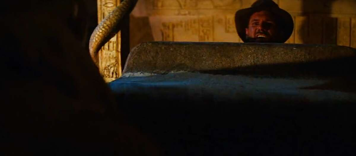 Raiders of the Lost Ark (1981) In Raiders of the Lost Ark, Steven Spielberg throws in a drawing of RD2D and C-3PO on the pillar left of Indiana Jones.