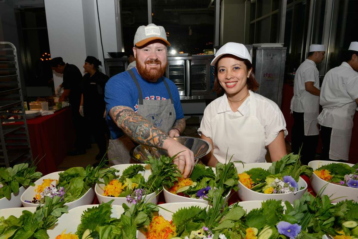 Chefs Kevin Gillespie, left, and Angela Dimayuga attend The (RED) Supper hosted by Mario Batali with Anthony Bourdain on June 2, 2016 in New York City. Dimayuga recently earned some attention for a response turning down an interview with IvankaTrump.com.