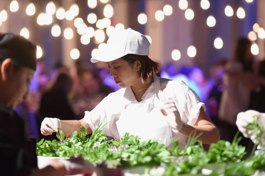 Chef Angela Dimayuga attends The (RED) Supper hosted by Mario Batali with  Anthony Bourdain
