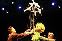 """Swazzle brings its production of """"The Little Prince"""" to Fairfield on Sunday, April 23. Here, the aviator, lost in the Sahara Desert, and the prince play with birds."""