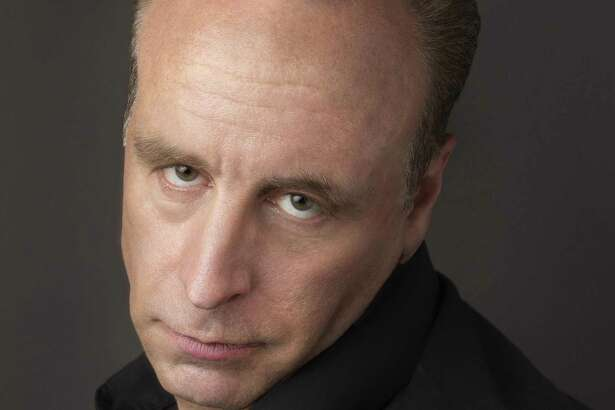 Comedian Vic DiBitetto performs at Edmond Town Hall Theater in Newtown on Friday, April 21.