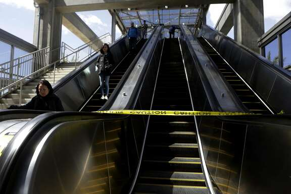 People ride an escalator to exit at Warm Springs BART Station on Friday, April 14, 2017, in Fremont, Calif.