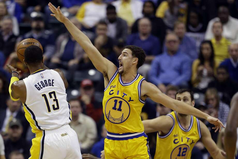 Golden State Warriors guard Klay Thompson (11) stops the shot of Indiana Pacers forward Paul George (13) during the first half of an NBA basketball game in Indianapolis, Tuesday, Dec. 8, 2015. (AP Photo/Michael Conroy) Photo: Michael Conroy, Associated Press
