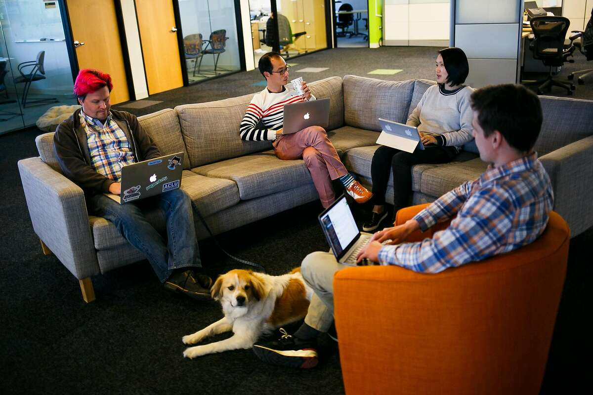 From the left, Andrew Hammond, Taku Kawane, Ivy Yu, and Andrey Burin work in the common workspace area at AnchorFree in Menlo Park, Calif. Friday, April 14, 2017.
