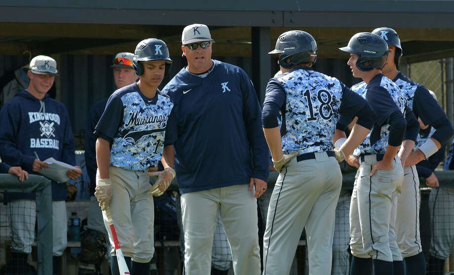 Kingwood Head Coach Kelly Mead, center, pumps up his team against Clear Lake during their matchup in the Clear Creek ISD Varsity Baseball Tournament at Clear Lake High School on March 2, 2017. (Photo by Jerry Baker/Freelance) Photo: Jerry Baker, Freelance / Freelance