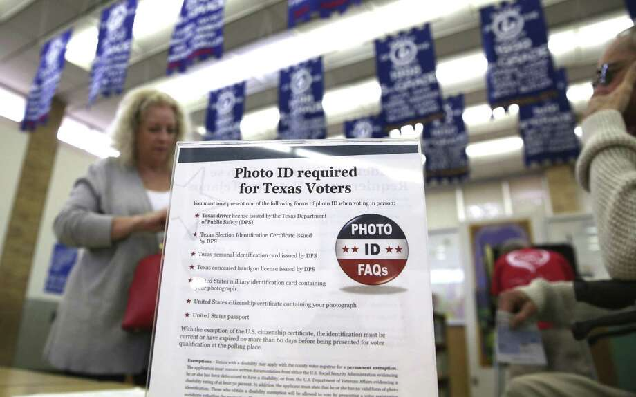A sign tells voters of voter ID requirements before participating in the primary election at Sherrod Elementary school in Arlington on March 1, 2016. After court orders undermined the Texas voter ID law, the Legislature is mulling a substitute, but it, too, discriminates. Photo: LM Otero /Associated Press / Copyright 2017 The Associated Press. All rights reserved.