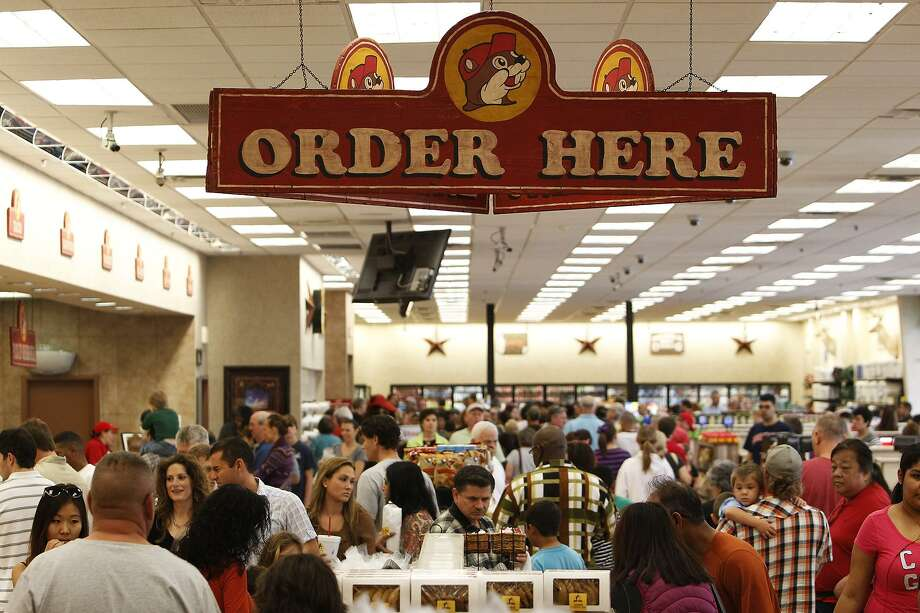 Shoppers browse the selection during Black Friday at Buc-ee's in Luling on Friday, Nov. 23, 2012. Buc-ee's, which is based in Lake Jackson, has filed a number of suits to establish a binding claim on certain aspects of its road stop branding. The company has gone after a number of competitors who employ cartoon mascots, including a smiling dog, chickens and a farmer, according to court documents. Photo: Michael Miller /San Antonio Express-News / © San Antonio Express-News