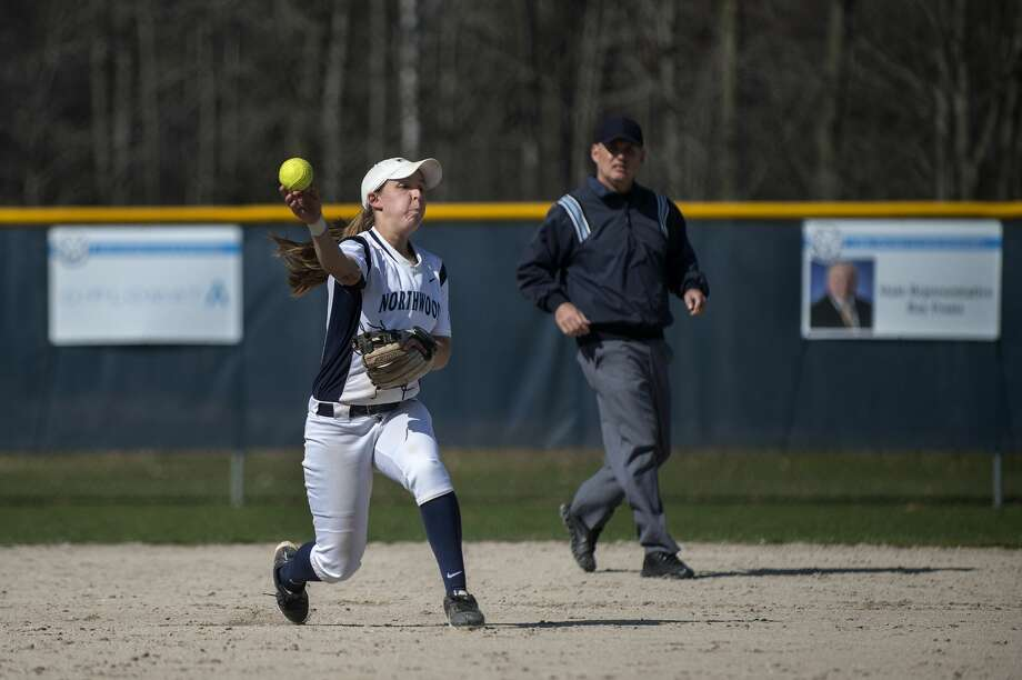 BRITTNEY LOHMILLER | blohmiller@mdn.net Northwood's Danielle Bartodziej throws the ball to teammate Torriya Gray-Baker to force out a Grand Valley State University runner in the fifth inning of the Friday afternoon game. Grand Valley defeated Northwood 3-0. Photo: Brittney Lohmiller/Midland Daily News/Brittney Lohmiller
