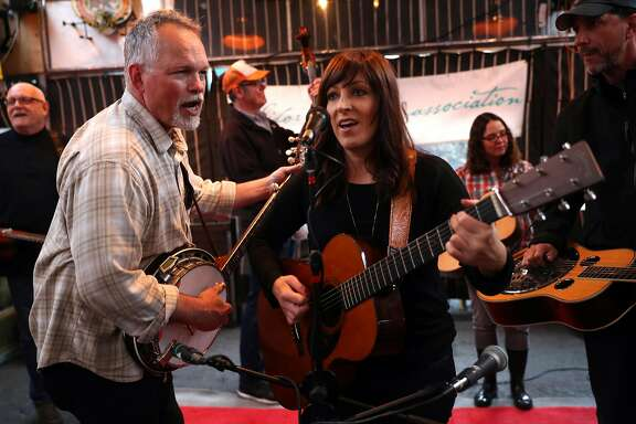Ted Kuster and Jenna Fiamingo during jam session by the San Francisco chapter of the California Bluegrass Association in San Francisco, Calif., on Thursday, April 6, 2017.