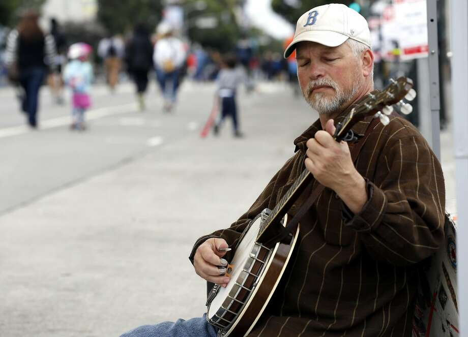 Ted Kuster of the California Bluegrass Association plays a banjo during Sunday Streets festival in the Mission District of San Francisco earlier this month. Photo: Connor Radnovich, The Chronicle