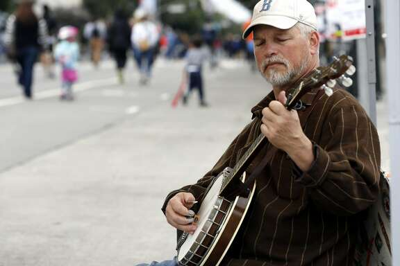 Ted Kuster of the California Bluegrass Association plays a banjo during Sunday Streets festival in the Mission District of San Francisco, California, on Sunday, April 10, 2016.