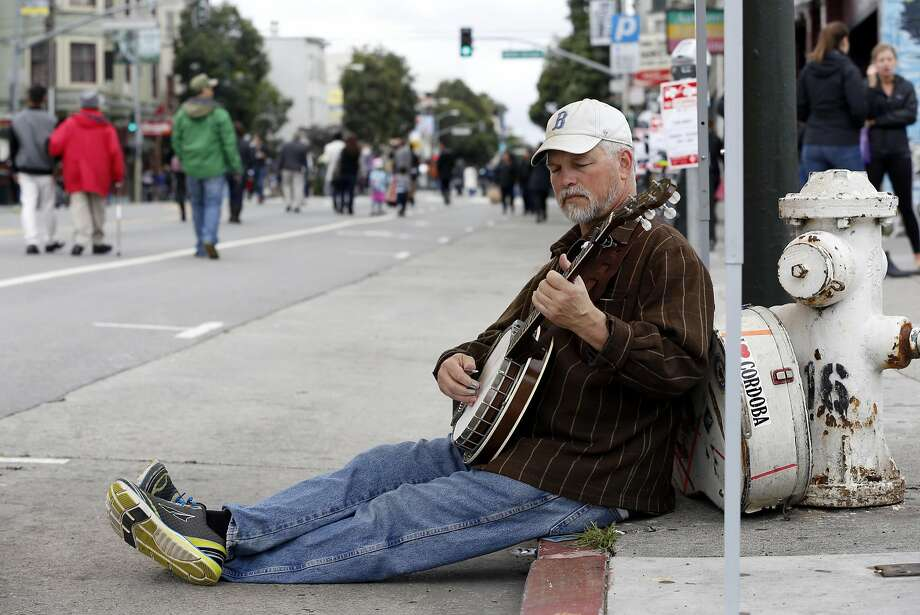 Ted Kuster of the California Bluegrass Association plays a banjo during Sunday Streets festival in the Mission District of San Francisco, California, on Sunday, April 10, 2016. Photo: Connor Radnovich, The Chronicle